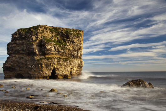 A Large Rock Formation Off The Coast Wall Mural