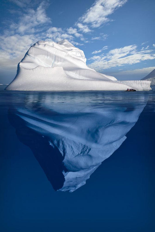A Composite Image Of Tourists Exploring An Iceberg Wall Mural