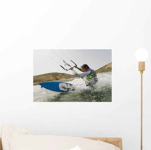 A Man Kite Surfing Off The Coast Of Parque Natural Del Estrecho Wall Mural