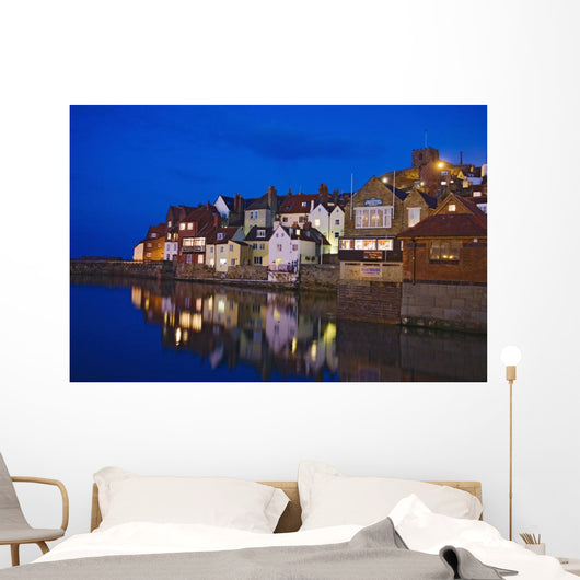 UK, Yorkshire, Houses reflecting in water at dusk Wall Mural