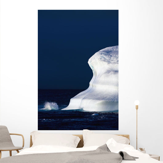 Ocean Water Splashing Against An Iceberg In The High Arctic Waters Wall Mural