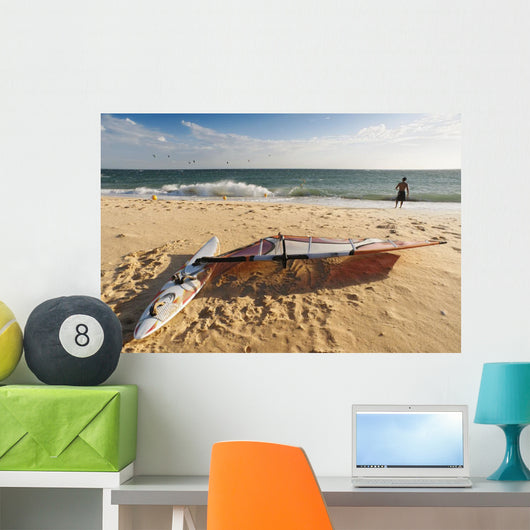 A Man On The Beach With His Windsurfing Board Wall Mural