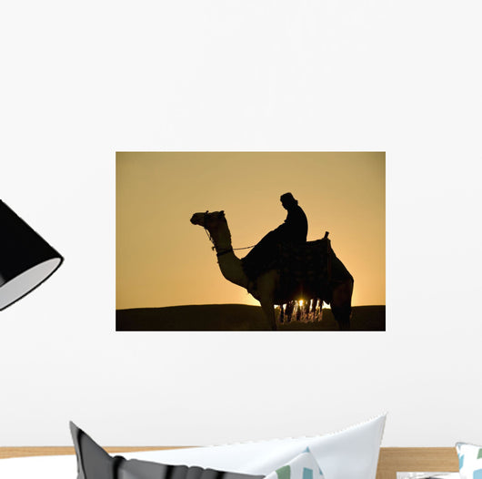 Man On Camel At Dusk Near The Pyramids Wall Mural