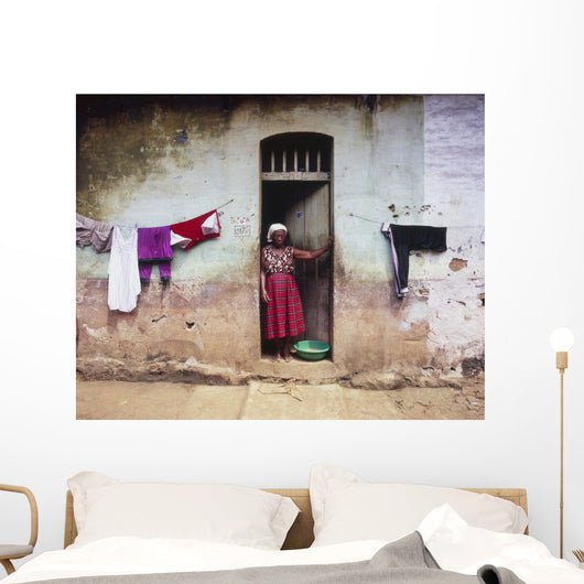 Woman In Front Of The House Wall Mural