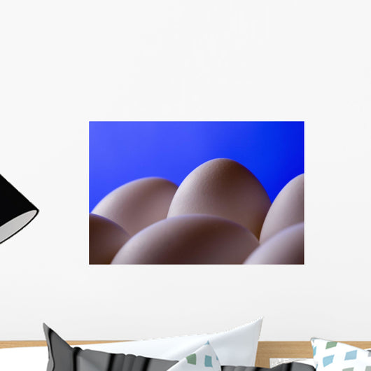Close-Up Eggs Against Blue Background Wall Mural
