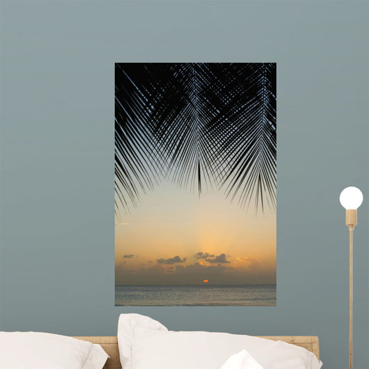 Looking Through Palm Trees To Sunset On The West Coast Of Barbados Wall Mural