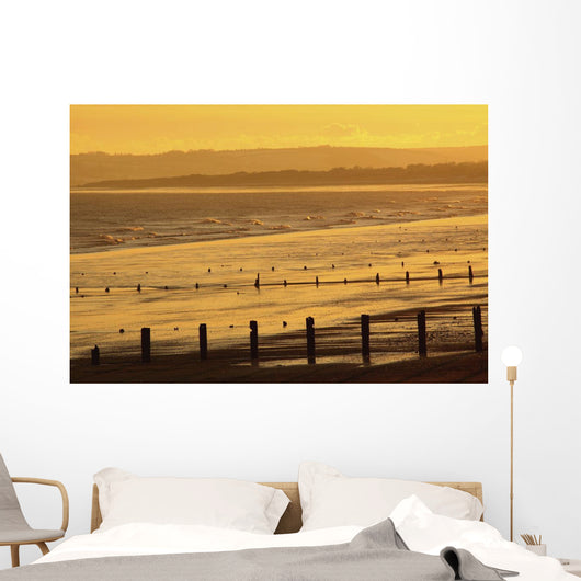 Sunset Over Beach In Winter Wall Mural