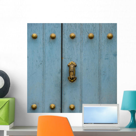 A Blue Door With Brass Decorative Knobs Wall Mural