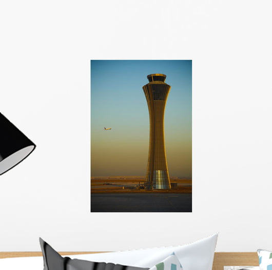 An Airplane Flies Past The Air Traffic Control Tower Wall Mural