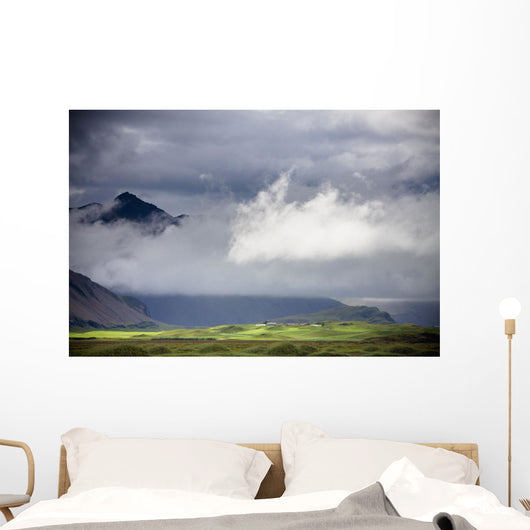 The Peak Of A Mountain Seen Through Low Lying Clouds Wall Mural