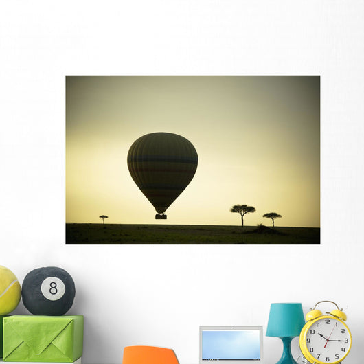 Silhouette Of A Hot Air Balloon Just Off The Ground At Dusk Wall Mural