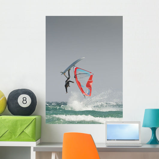 A Windsurfer Flips Upside Down On The Water Off Valdevaqueros Beach Wall Mural