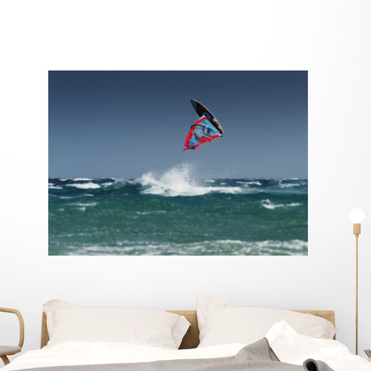 A Windsurfer Flips Upside Down Above The Water Off Punta Paloma Wall Mural