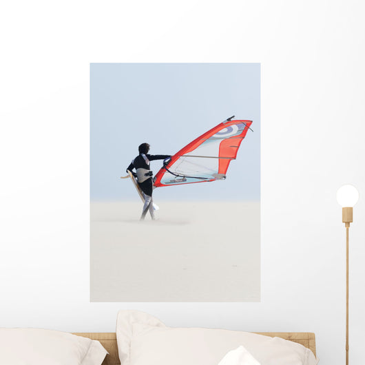 A Windsurfer Walks On The Sand Of Punta Paloma Beach With His Board Wall Mural