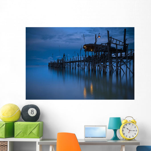 A Wooden Pier With Lights On It At Night Wall Mural