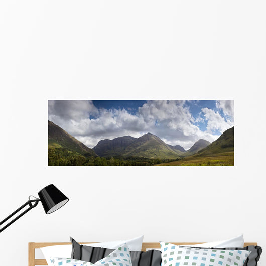 A Mountainous Landscape Under Clouds Wall Mural