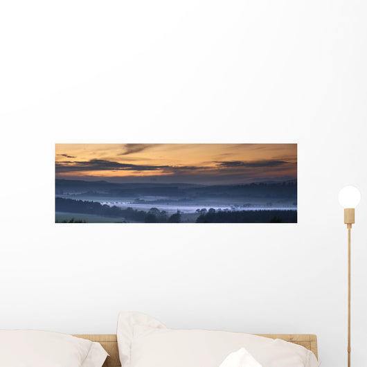 Fog Lies Over A Town At Sunset Wall Mural