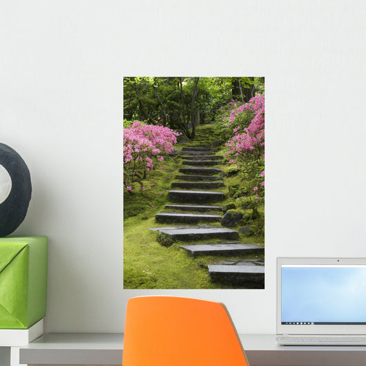 Rock Stairway Along A Moss Covered Hill With Flowering Bushes Wall Mural