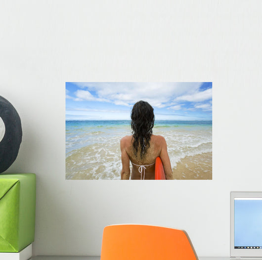 Hawaii, Kauai, Woman Holding Surfboard On Beach, View From Behind Wall Mural
