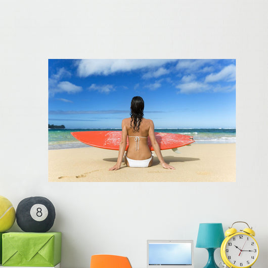Hawaii, Kauai, Woman Sitting On Beach With Surfboard, View From Behind Wall Mural