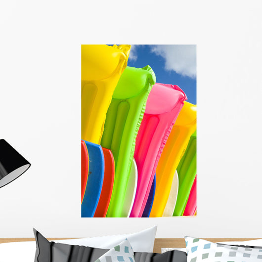 Close-Up View Of Colorful Plastic Rafts And Boogie Boards Wall Mural
