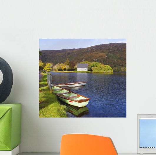 St Finbarre's Oratory And Rowing Boats On Shore Of Gougane Barra Lake Wall Mural