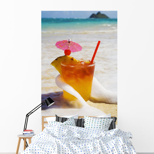 Mai Tai Getting Splashed By A Wave As It Rest On The Beach Wall Mural