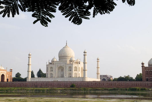 India, Temple burial site seen from Yamuna River at sunset Wall Mural