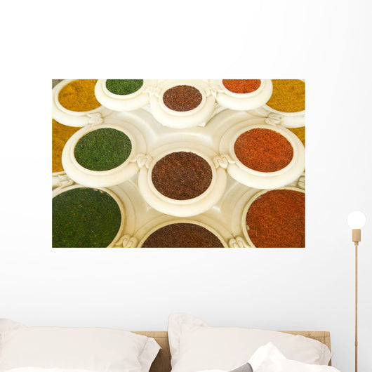 India, Agra, Abstract Colorful Bowls Of Spices In Vases From Above Wall Mural