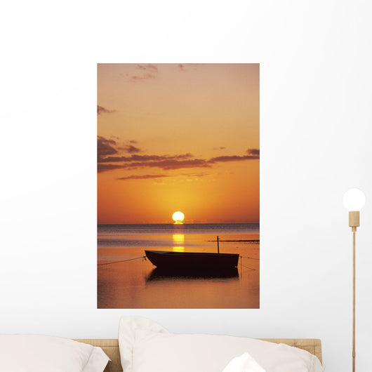 Sun Setting Over Ocean, Boat Silhouetted Against Orange Sky Wall Mural