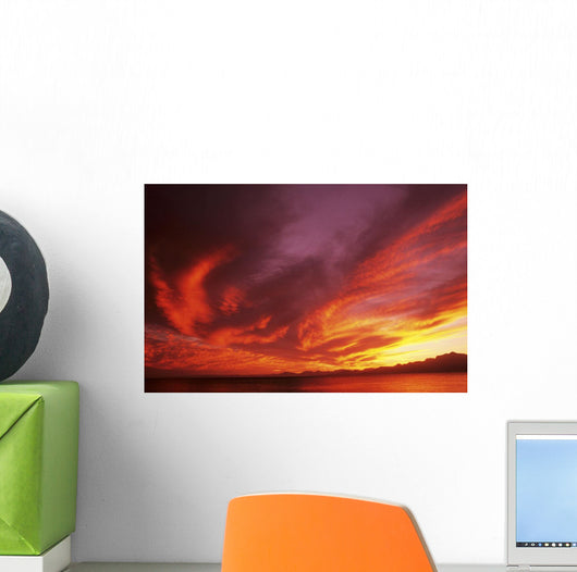 Sunset Over Seascape, Brightly Colored Clouds Illuminated Over Ocean Wall Mural