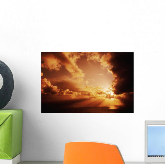 Orange Sunset Over Ocean, Sunrays Bursting Through Puffy Clouds Wall Mural