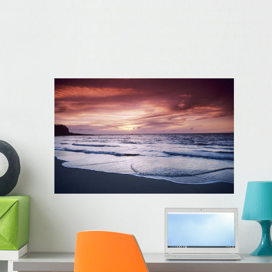 USA, Colorful sunset over ocean and beach Wall Mural