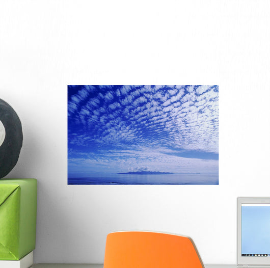 Cotton-Like Clouds In Blue Sky Over Smooth Ocean Water Wall Mural