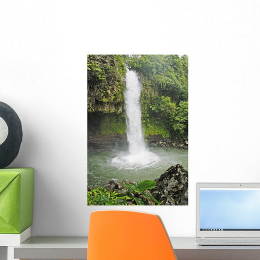 Fiji, Taveuni, Tavoro Waterfall cascading into tropical pool Wall Mural