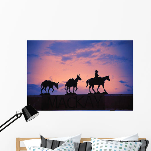 Silhouette Of Donkey Train Statue Against Sunset Wall Mural