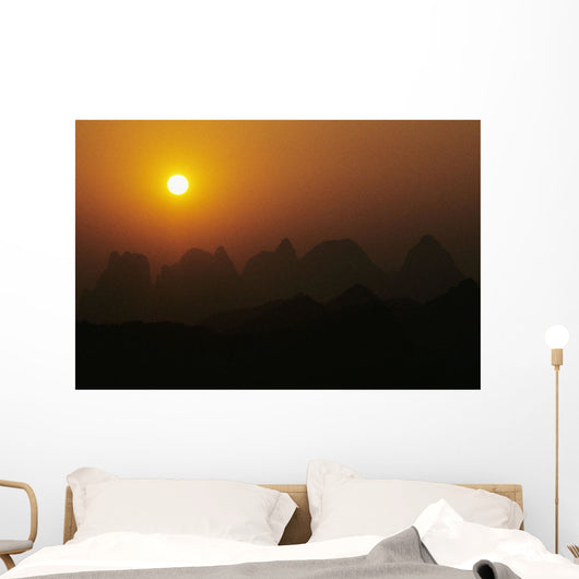 China, Guilin, Piled Silk Mountains, Orange Misty Sunset Wall Mural
