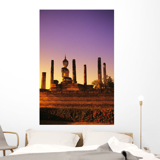 Glowing sunlight on structure of Buddha statue with many pillars Wall Mural