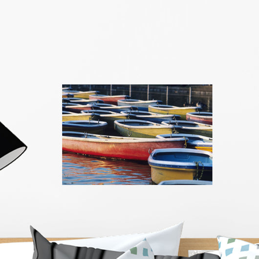 Japan, Tokyo, Ueno Park, Colorful Row Boats Tied Together On Lake Wall Mural