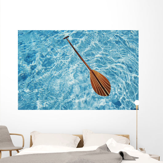 Overhead View Of Paddle Floating On Surface Of Turquoise Water Wall Mural
