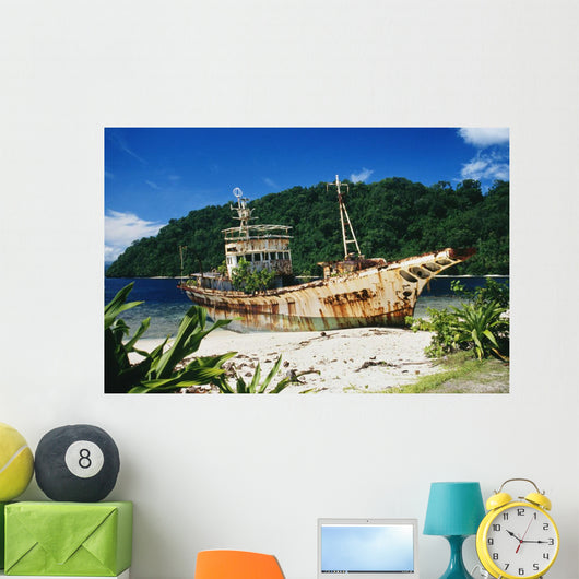 Shipwrecked fishing boat on beach Wall Mural