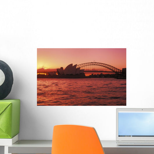 Australia, New South Wales, Opera House and Harbor Bridge at sunset Wall Mural