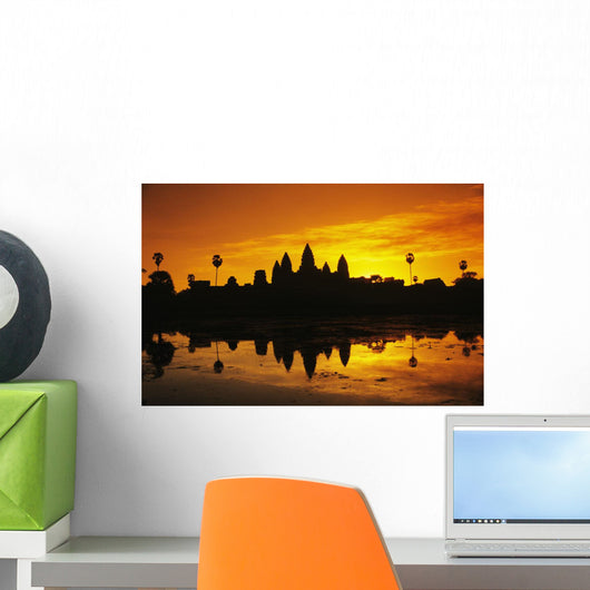 Silhouette of temple against orange sky during sunrise Wall Mural