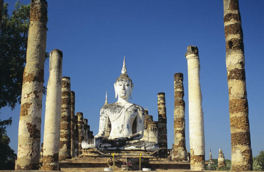 Thailand, Sukhotha, View of Buddha Statue And Pillars Wall Mural