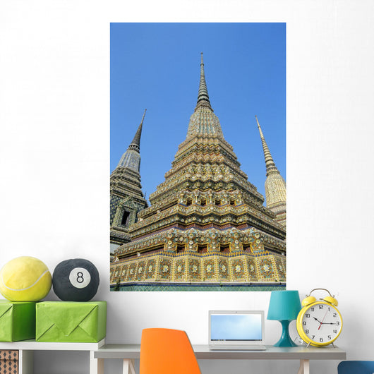 Thailand, Bangkok, Colorful Pointed Steeples Against Clear Blue Sky Wall Mural
