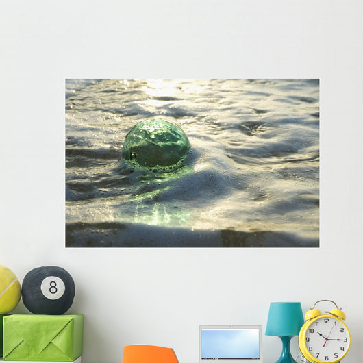 A Glass Fishing Ball Floats In Shallow Water, Bright Reflections Wall Mural
