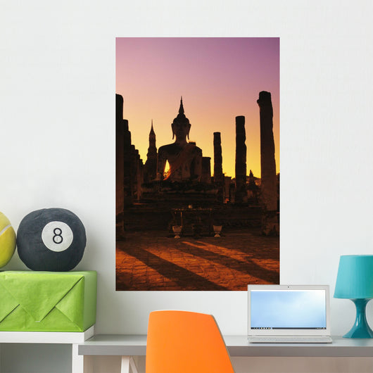 Buddha And Pillars Backlit At Sunset Wall Mural