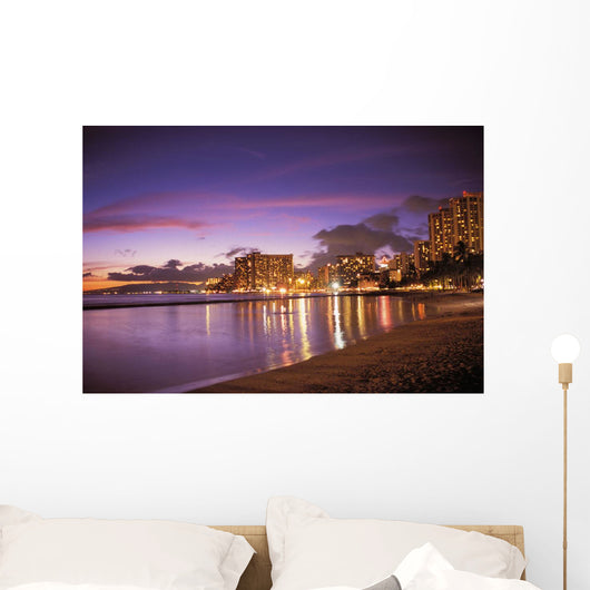Reflection Of City Lights On The Ocean At Twilight Wall Mural