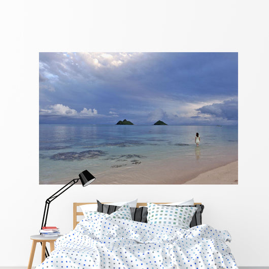 Hawaii, Oahu, Lanikai, A Woman Wades In The Water At The Beach At Dusk Wall Mural
