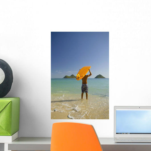 Surfer Walking Into The Water From The Beach With Board Over His Head Wall Mural